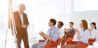Business people applauding at the end of a conference. In the office royalty free stock photo