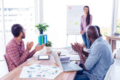 Business people applauding for female businesswoman Royalty Free Stock Photo