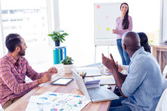 Business people applauding for female colleague. In creative office Stock Photos