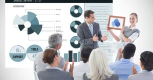 Business people applauding for female executive against graphs. Digital composite of Business people applauding for female executive against graphs Stock Image