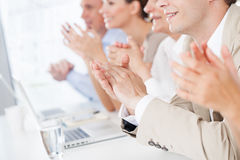 Business People Applauding. Group of business people applauding in a meeting Stock Photos