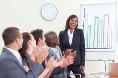 Business people applauding her colleague. After giving a presentation Stock Photos