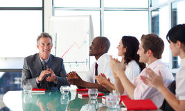 Business people applauding in a meeting. International business people applauding in a meeting Stock Photos