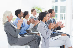 Business people applauding during meeting. In office Stock Image