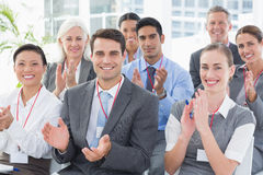 Business people applauding during meeting. In office Stock Photography