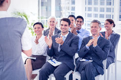 Business people applauding during meeting. In office Royalty Free Stock Images
