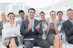Business people applauding during meeting. In office Royalty Free Stock Photo