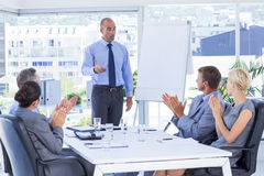 Business people applauding during meeting Stock Photo