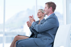 Business people applauding during meeting Stock Photos