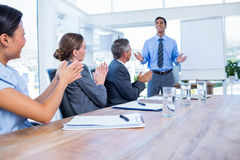 Business people applauding during a meeting. In the office Royalty Free Stock Photography