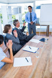 Business people applauding during a meeting Stock Photo