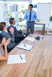 Business people applauding during a meeting Stock Photography