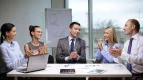 Business people applauding on meeting. Office and teamwork concept - group of business people applauding on meeting stock video