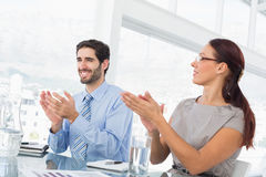 Business people applauding at meeting Royalty Free Stock Photo