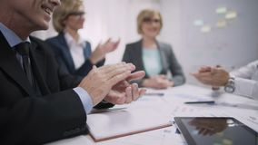Business people applauding in office, company team achievement, success concept