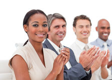 Business people applauding a presentation. International business people applauding a presentation in the office Stock Images