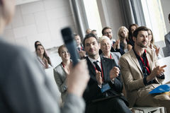 Business people applauding for public speaker during seminar.  Royalty Free Stock Images