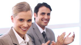 Business people applauding. While sitting in a bright office stock video
