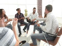 Business people are applauding. And smiling while sitting in circle in office stock photos