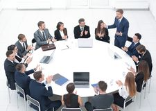 Business people applauding speaker at a business meeting. The concept of partnership Stock Photo