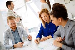 Group of business people working as team in office royalty free stock photo
