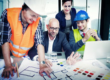 Business People and Architects in a Meeting Stock Image