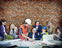 Business People and Architects in a Meeting Stock Photography