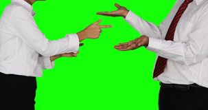 Business people arguing in the studio. Hands gesture of two faceless business people arguing in the studio with green screen background. Shot in 4k resolution