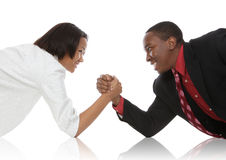 Business People Arm Wrestling. Attractive african american business man and woman arm wrestling Royalty Free Stock Photos