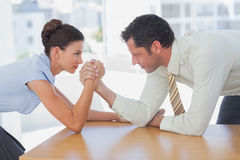 Business people arm wrestling Royalty Free Stock Images