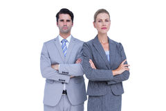 Business people with arms crossed looking at camera Royalty Free Stock Photo