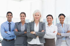 Business people with arms crossed smiling at camera Stock Images