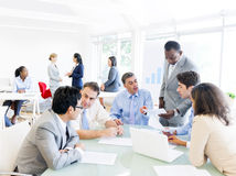 Business People Around Conference Table Stock Image