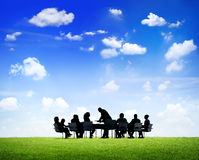 Business People Around The Table Outdoor. Business People Discussing Around The Conference Table Outdoors In A Scenic View Royalty Free Stock Photography