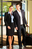 Business people arriving at Hotel. With suitcases Royalty Free Stock Images