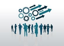 Business people with arrows and cogs and wheels Stock Photo