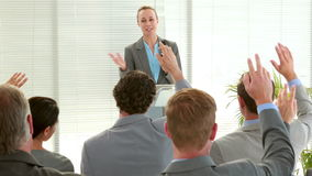 Business people asking question during meeting