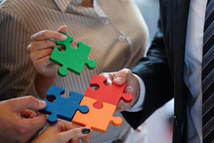 Business people assembling jigsaw Royalty Free Stock Images