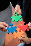 Business people assembling jigsaw Royalty Free Stock Image