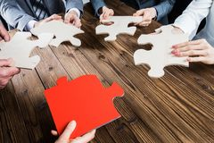 Business people assembling jigsaw puzzle Stock Images