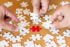 Business people assembling jigsaw puzzle, Teamwork concept stock image