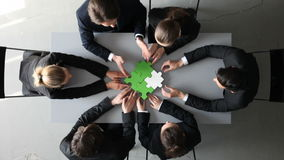 Business people assembling puzzle stock footage