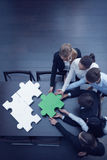 Business people assembling puzzle royalty free stock photos