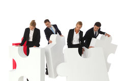 Business people assembling puzzle Stock Images