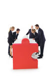 Business people assembling puzzle Royalty Free Stock Image