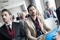Business people attending seminar in convention center.  Royalty Free Stock Photos