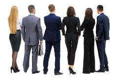 Business people from the back - looking at something over a whit Stock Photography