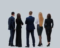 Business people from the back - looking at something over a white background. Business people from the back - looking at something over a white background Royalty Free Stock Photo