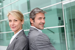 Business people back to back Stock Images