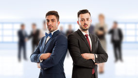 Business people back to back. Standing confident as competitors or partners Royalty Free Stock Photos